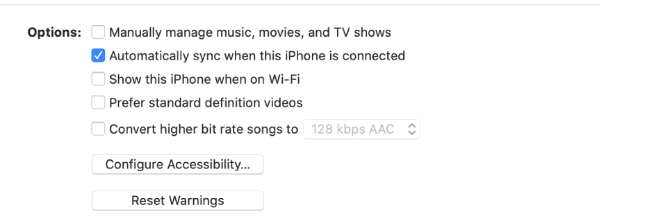 """The sync options showing checkboxes to manually manage content items, automatically sync, and display the device when connected over Wi-Fi. The """"Prefer standard definition videos"""" and """"Convert high bit rate songs options also appear. A Configure Accessibility button and a Reset Warning button also appear."""