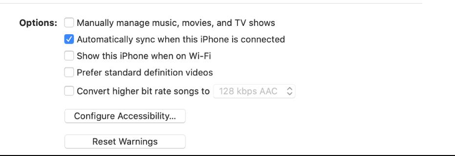 De synchronisatieopties met aankruisvakken om materiaalonderdelen handmatig te beheren, automatisch te synchroniseren en het apparaat weer te geven als het via wifi is verbonden. De opties 'Gebruik bij voorkeur SD-video's' en 'Zet nummers met hogere bitsnelheid om naar' zijn ook te zien. Ook de knoppen 'Configureer toegankelijkheid' en 'Stel waarschuwingen opnieuw in' zijn te zien.