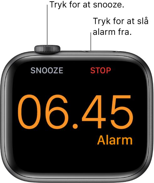 """Et Apple Watch, der ligger på siden, hvor skærmen viser en alarm, der er aktiveret. Under DigitalCrown ses ordet """"Snooze"""". Under sideknappen står ordet """"Stop""""."""