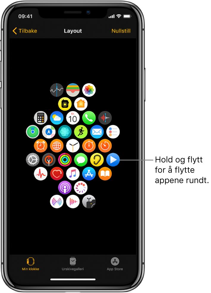 Layoutskjermen i Apple Watch-appen på iPhone som viser et symbolrutenett. En bildetekst peker på et appsymbol og har teksten «Hold og flytt for å flytte appene rundt».