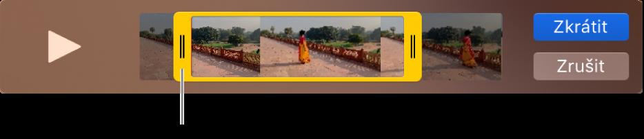 Klip vokně QuickTime Playeru; část klipu je ohraničena žlutými úchyty azbývající část je mimo úchyty. Napravo jsou vidět tlačítka Zkrátit aZrušit