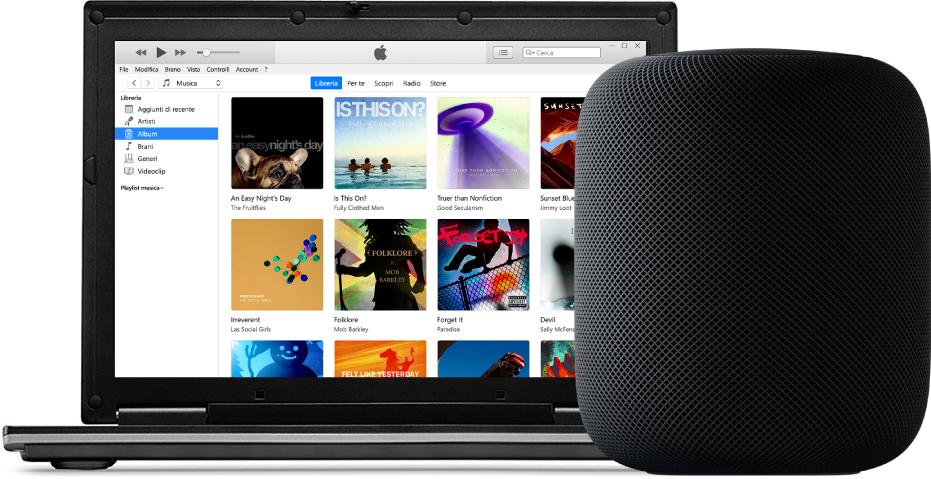 Un PC con iTunes sullo schermo e un HomePod vicino.
