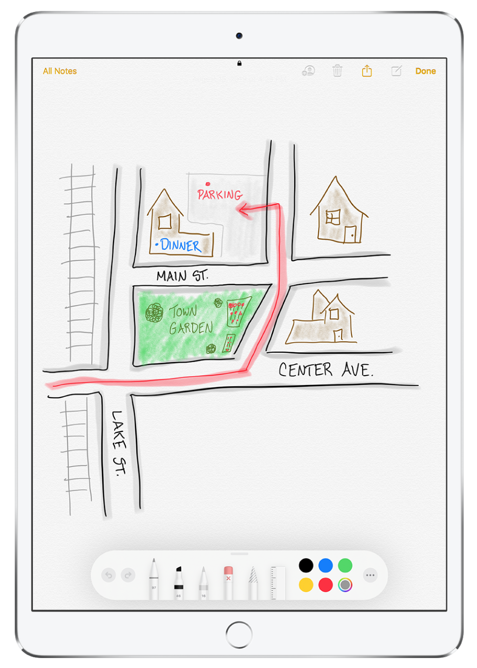 A drawing of a neighborhood inside a note in the Notes app. The drawing includes labeled streets and a red arrow directing to available parking. Along the bottom of the screen is the Markup toolbar with a writing utensil and a custom color selected.