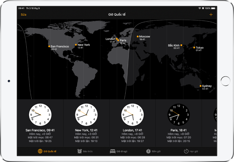 Tab Giờ quốc tế, đang hiển thị thời gian tại nhiều thành phố. Chạm vào Sửa ở trên cùng bên trái để sắp xếp các đồng hồ. Chạm vào nút Thêm ở trên cùng bên phải để thêm đồng hồ khác. Các nút Báo thức, Giờ đi ngủ, Bấm giờ và Hẹn giờ nằm ở dưới cùng.