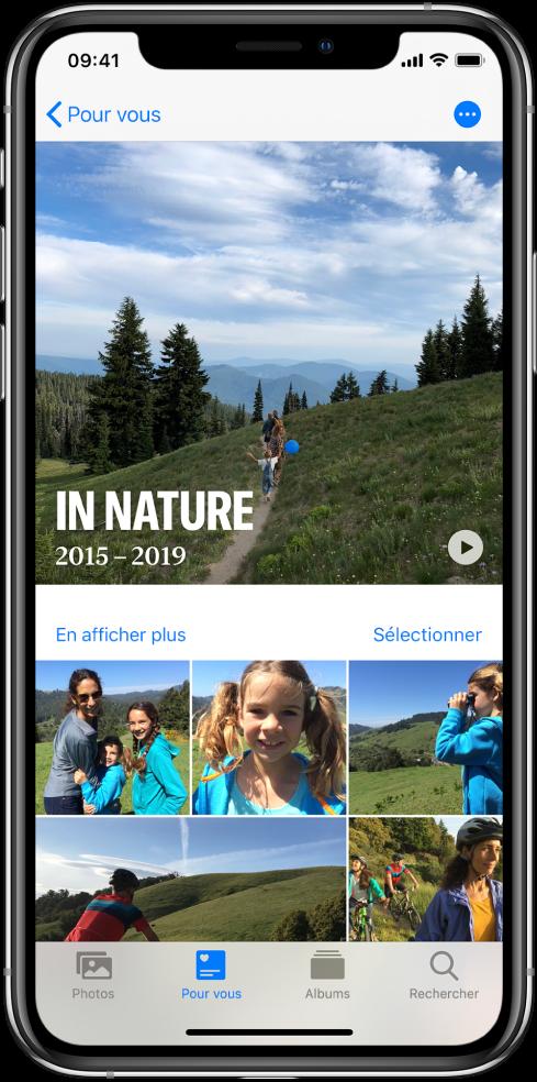 Un écran Souvenirs présentant une vidéo en haut. Une collection de photos est affichée en dessous.