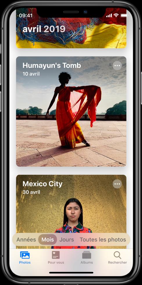 Un écran dans l'app Photos. L'onglet Photos et la présentation par mois sont sélectionnés. Deux événements du mois d'avril2019, Tombe de Humayun et Mexico, sont affichés.