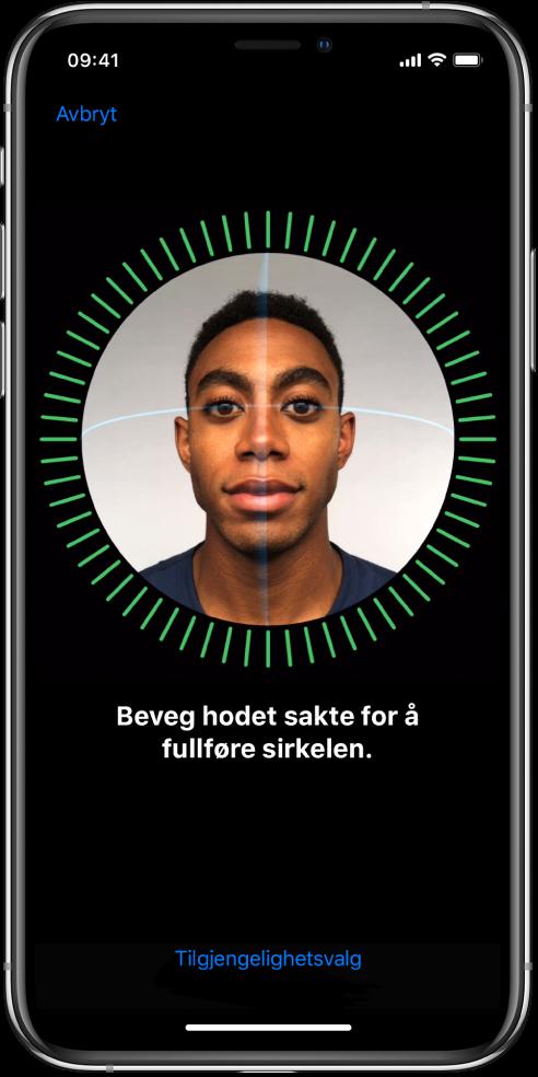 Konfigureringsskjermen for Face ID-gjenkjenning. Et ansikt vises på skjermen, omsluttet av en sirkel. Teksten under ber deg om å bevege hodet sakte for å fullføre sirkelen.