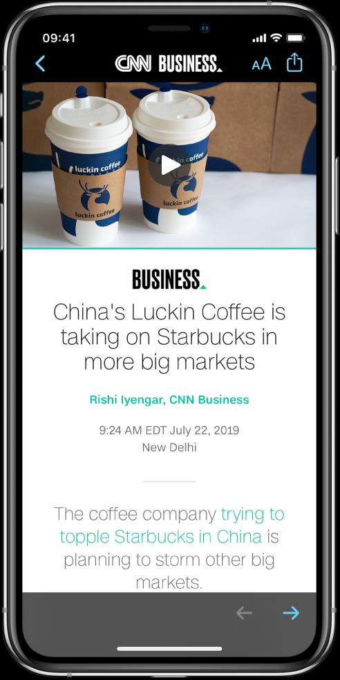 En artikkel fra Apple News. Øverst til venstre på skjermen er Tilbake-knappen for å gå tilbake til Aksjer-appen. Øverst til høyre på skjermen er Tekstformat- og Del-knappen. Nede til høyre er Neste side-knappen.
