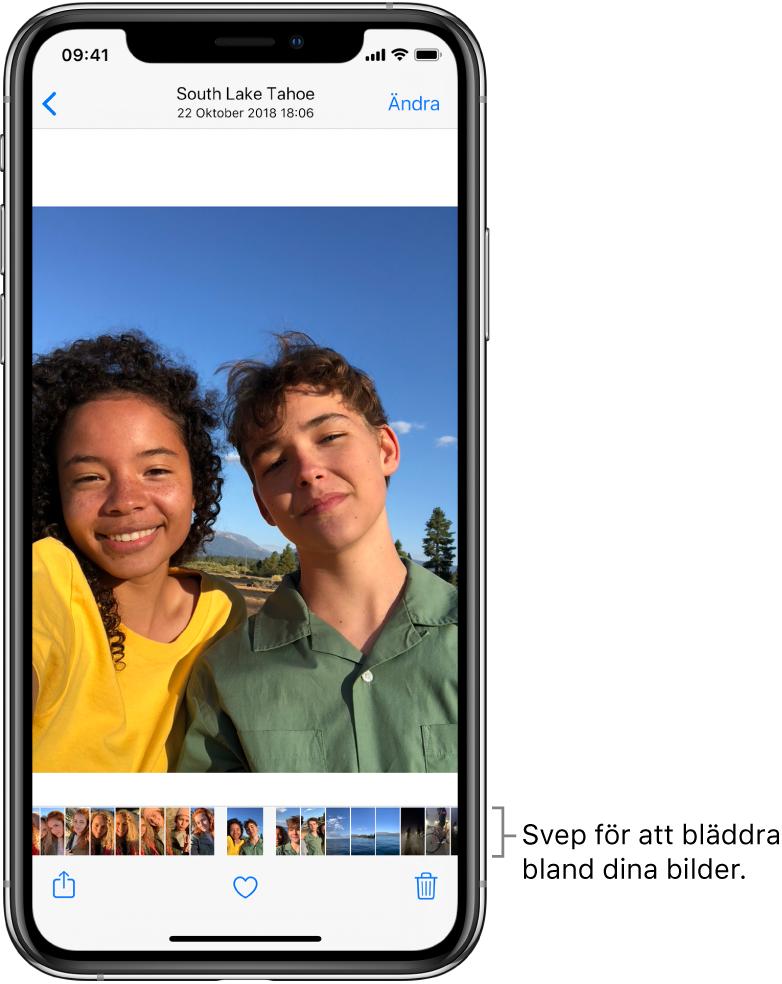 En bild med miniatyrer av andra bilder längs skärmens nederkant. Överst till vänster finns en tillbakaknapp som du använder för att komma tillbaka till vyn där du bläddrade. Längs nederkanten finns knapparna för att dela, gilla och radera. Högst upp till höger finns knappen Ändra.
