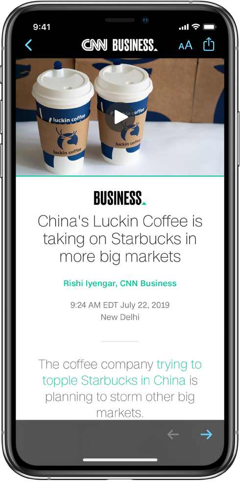 """来自 Apple 新闻的文章。屏幕左上方是返回""""股市"""" App 的""""返回""""按钮。屏幕右上角是""""文本格式""""和""""共享""""按钮。右下角是""""下一页""""按钮。"""