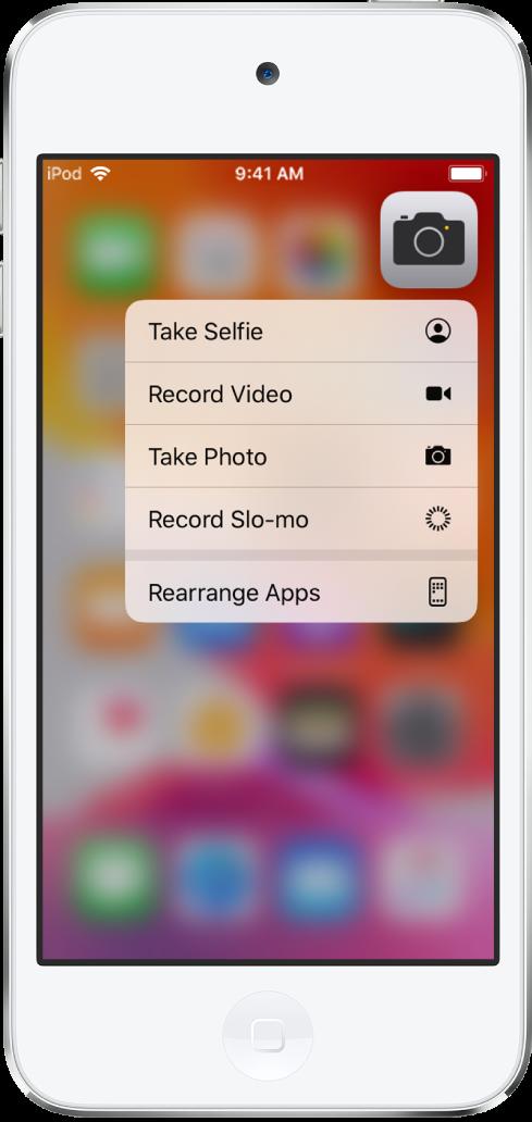 Tela de Início desfocada, com o menu de ações rápidas da Câmera abaixo do app Câmera.
