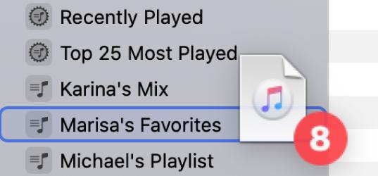 Bir listeye sürüklenmiş bir albüm. Liste mavi bir dikdörtgen ile vurgulanır.