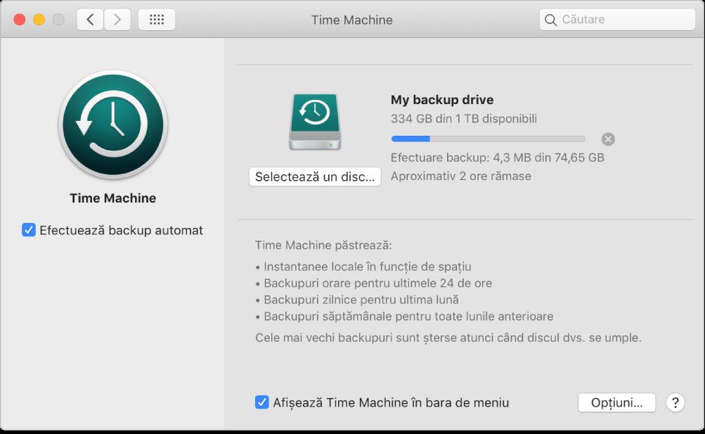 Preferințele pentru Time Machine afișând progresul backupului pe un disc extern.