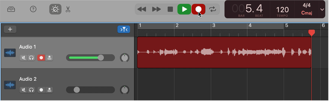 Showing a recorded audio region in red in the Tracks area.