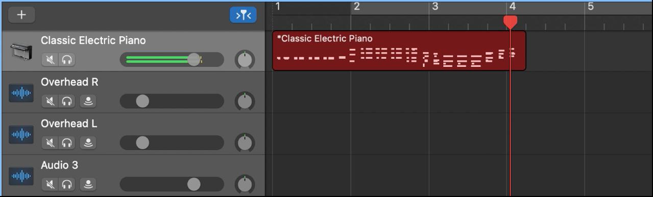 Région MIDI enregistrée apparaissant en rouge dans la zone Pistes.