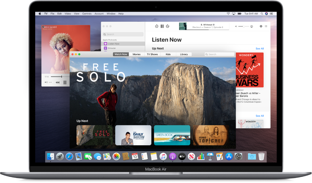 A MacBook Air desktop showing the Music, TV, and Podcasts windows open.