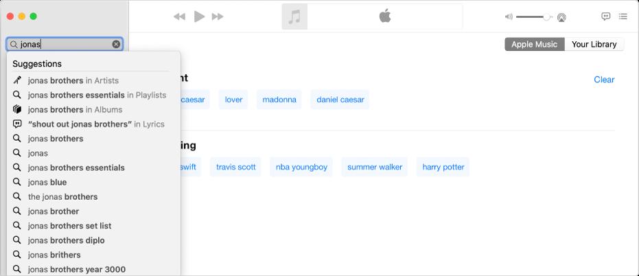 """Layar Musik menampilkan Apple Music dipilih di pojok kanan atas, dan """"Jonas"""" dimasukkan di bidang pencarian di pojok kiri atas. Hasil Apple Music yang disarankan untuk """"Jonas"""" ditampilkan di daftar di bawah bidang pencarian."""