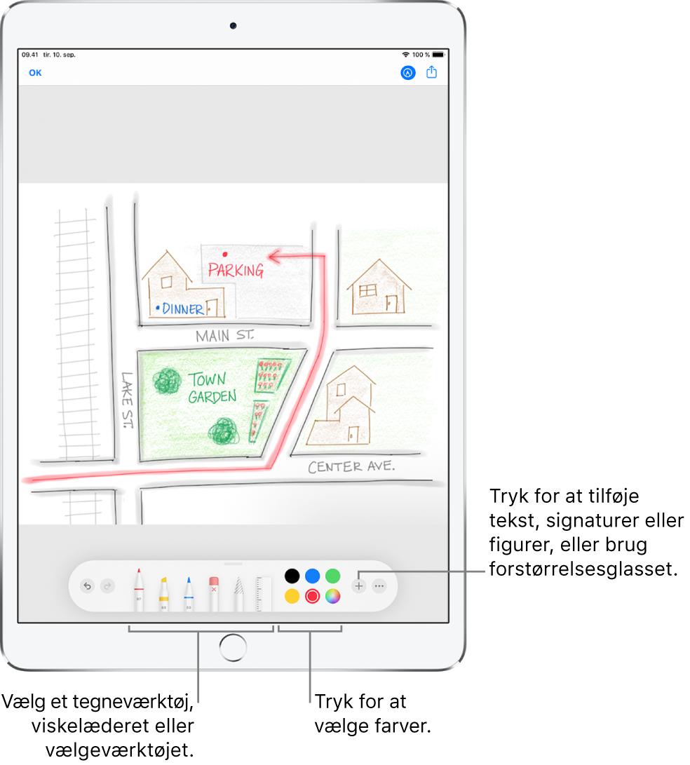 Et billede i et markeringsvindue. Under billedet ses fra venstre mod højre knapper til markeringsværktøjerne: penne, viskelæder, vælgeværktøj, farver og knapper til at tilføje et tekstfelt, din signatur og figurer og til at vælge forstørrelsesglasset.
