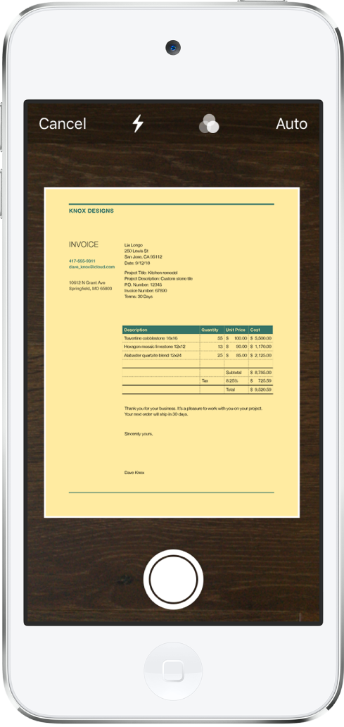 Un écran affichant un document en cours de numérisation. Le bouton de prise de photo est situé en bas au centre.