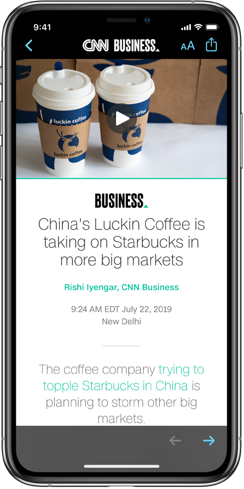 An article from Apple News. At the top-left of the screen is the Back button to return to the Stocks app. At the top-right corner of the screen are the Text Format and Share buttons. At the bottom-right corner is the Next Page button.