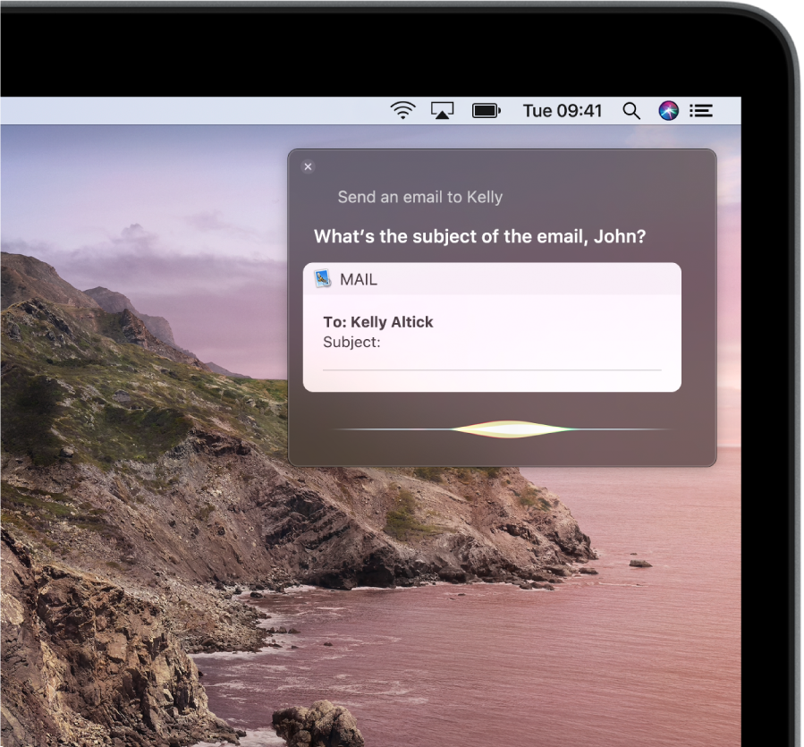 The Siri window in the top-right corner of the screen showing an email message being dictated.