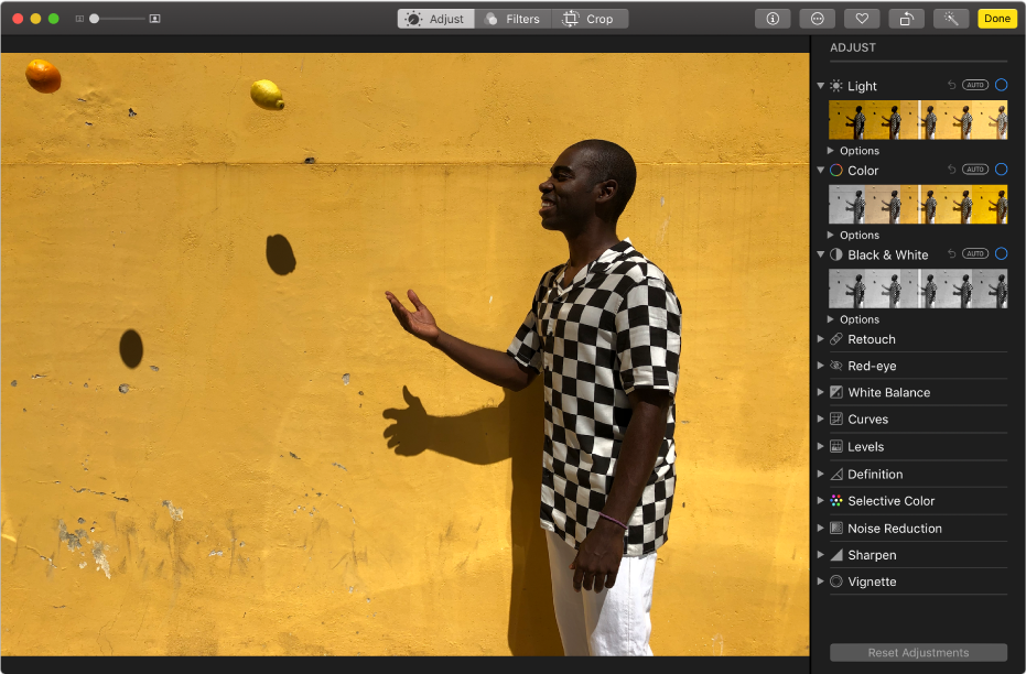 The Photos app window while editing a photo, with editing tools on the right.