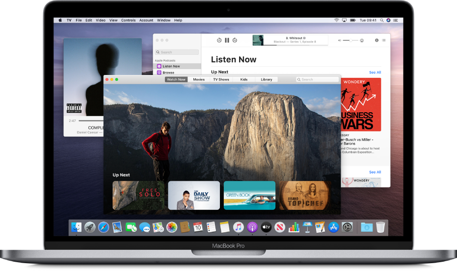 The Music Mini Player window, the Apple TV app window and the Podcasts window in the background.