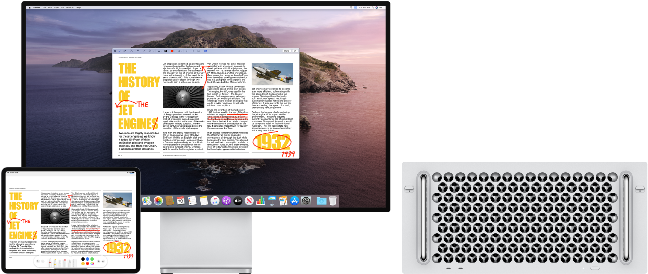 A Mac Pro and an iPad sit side by side. Both screens display an article covered in scribbled red edits, such as crossed out sentences, arrows, and added words. The iPad also has mark up controls at the bottom of the screen.