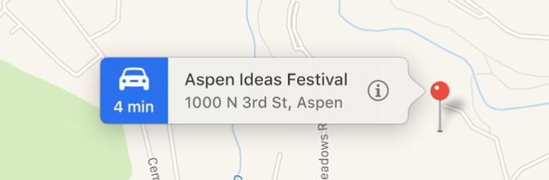Una ubicación marcada en un mapa con una tira que muestra el botón de información y la dirección.