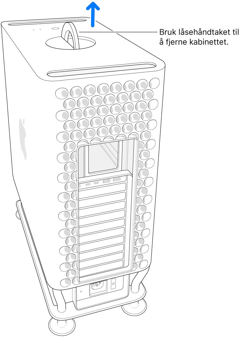 Låsehåndtaket vris og peker opp. Kabinettet løftes av maskinen.