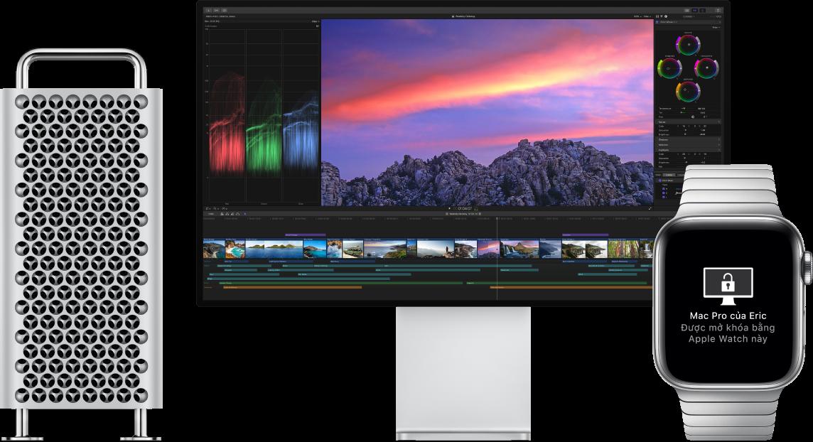 Một Mac Pro và màn hình, bên cạnh một AppleWatch đang hiển thị một thông báo rằng máy Mac đã được mở khóa bằng đồng hồ.