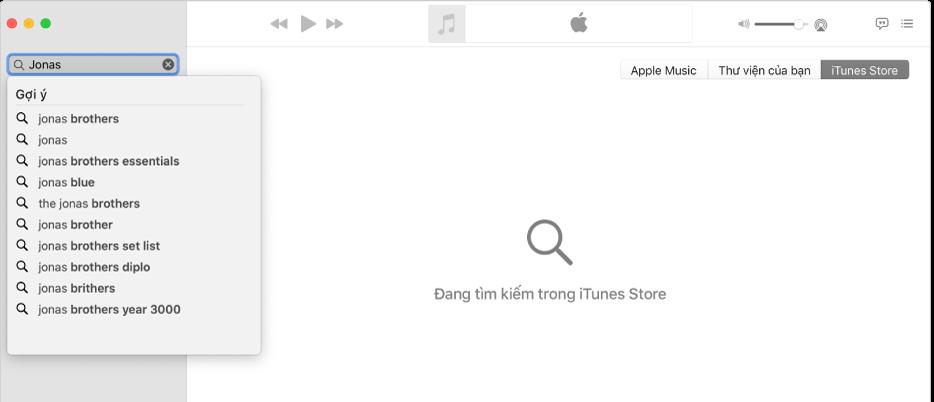"""Cửa sổ Nhạc đang hiển thị iTunes Store được chọn ở góc trên cùng bên phải và """"Jonas"""" được nhập vào trường tìm kiếm ở góc trên cùng bên trái. Các kết quả được gợi ý của iTunes Store cho """"Jonas"""" được hiển thị trong danh sách bên dưới trường tìm kiếm."""