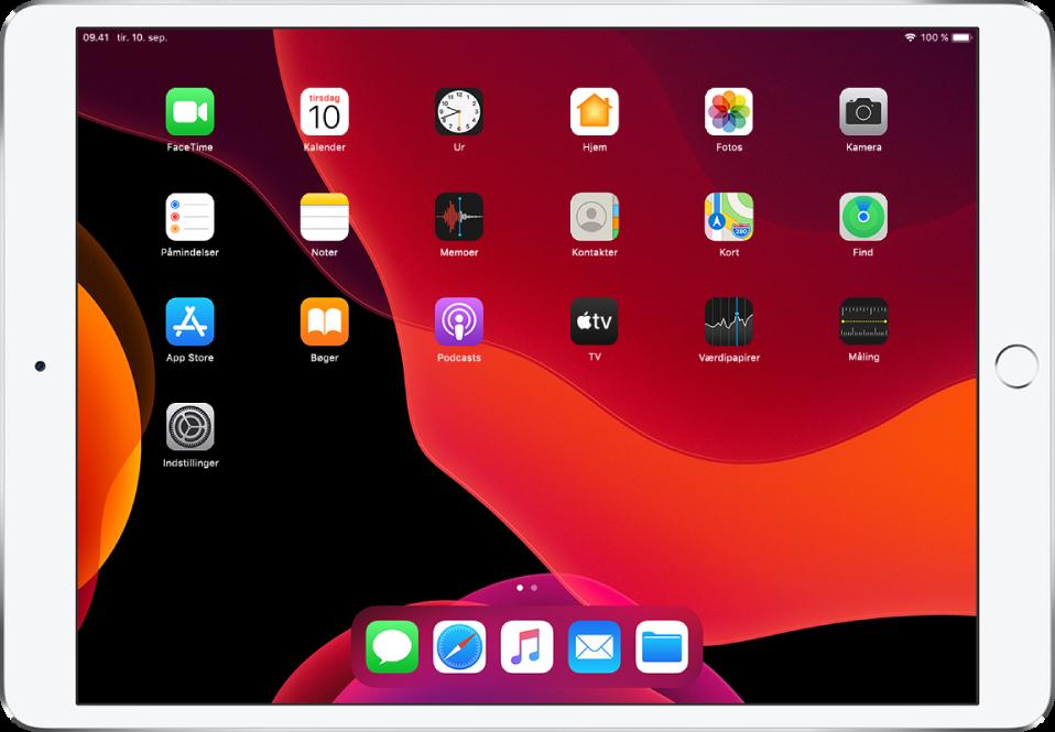 Hjemmeskærmen på iPad med funktionen Mørk slået til.