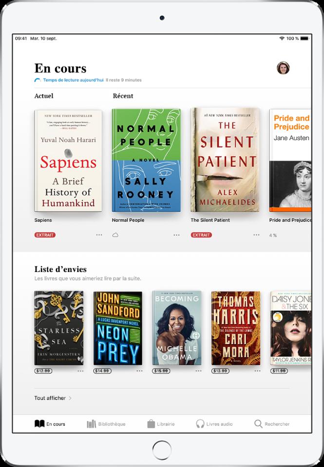 Un écran de l'app Livres. En bas de l'écran se trouvent, de gauche à droite, les onglets En cours, Bibliothèque, Librairie, Livres audio et Rechercher; l'onglet «En cours» est sélectionné. En haut de l'écran se trouve la section «En cours», qui présente les livres en cours de lecture. En dessous se trouve la section «Liste d'envies», qui présente les livres que vous pourriez avoir envie de lire.