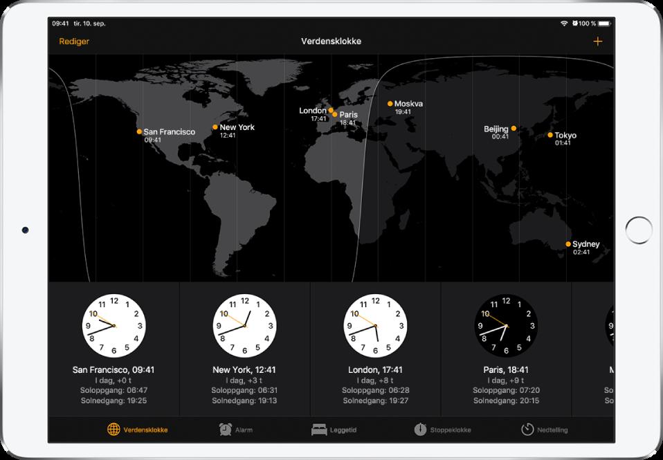 Verdensklokke-fanen, som viser klokkeslettet i forskjellige byer. Trykk på Rediger øverst til venstre for å endre rekkefølgen på klokkene. Trykk på Legg til-knappen øverst til høyre for å legge til flere. Knappene for Alarm, Leggetid, Stoppeklokke og Nedtelling vises nederst.