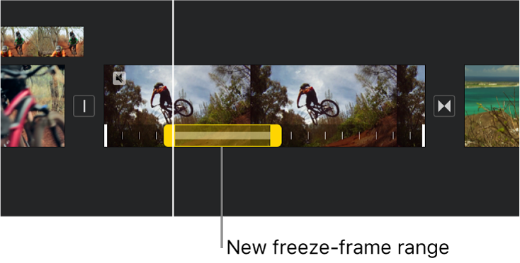A freeze frame with yellow range handles shown at the bottom of a video clip in the timeline, with the freeze frame beginning at the playhead position.