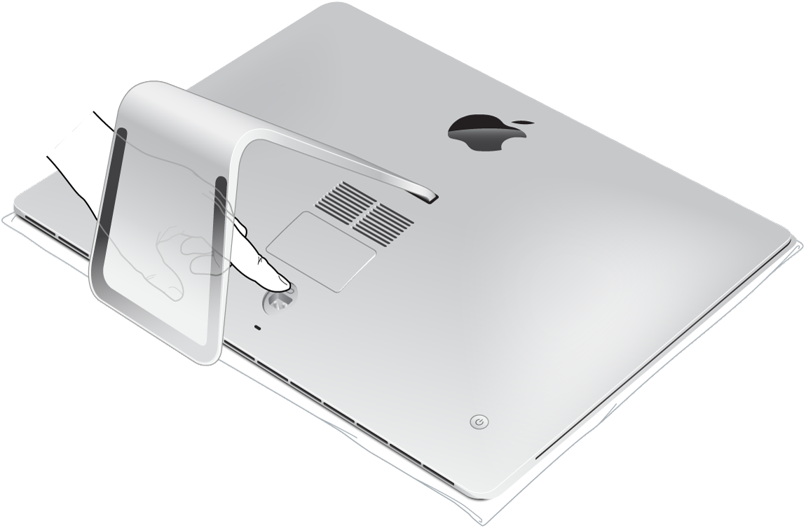 iMac lying flat on its screen with a finger pressing the memory compartment door button.