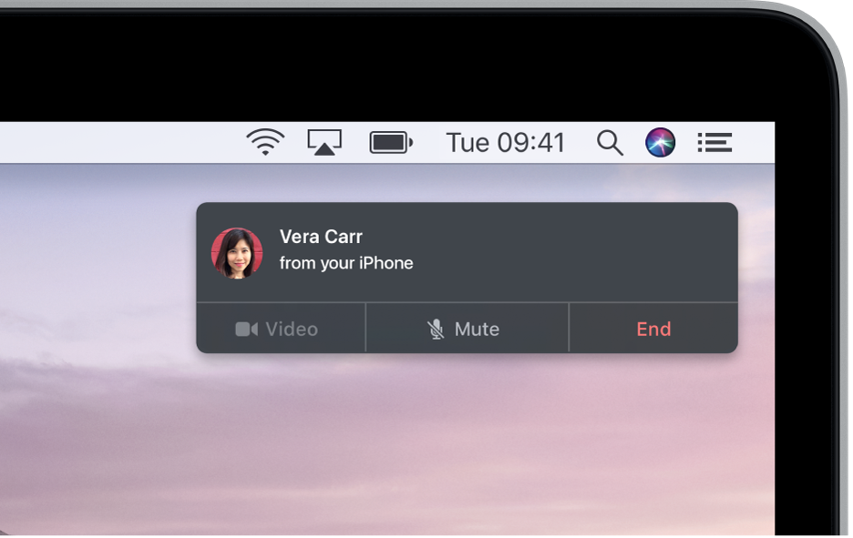A notification appears in the upper-right corner of the Mac screen, showing that a phone call is in progress using your iPhone.