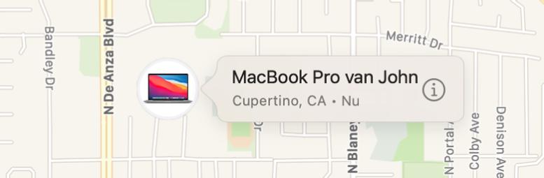 Een close-up van het infosymbool van Johns MacBookPro.
