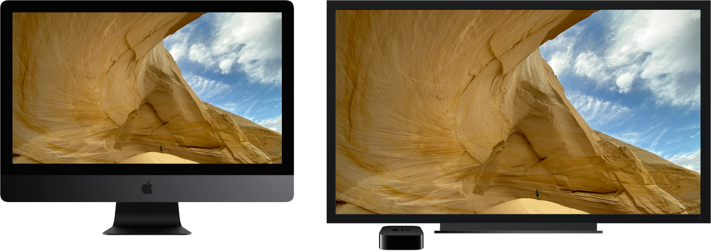 An iMac Pro with its content mirrored on a large HDTV using an Apple TV.