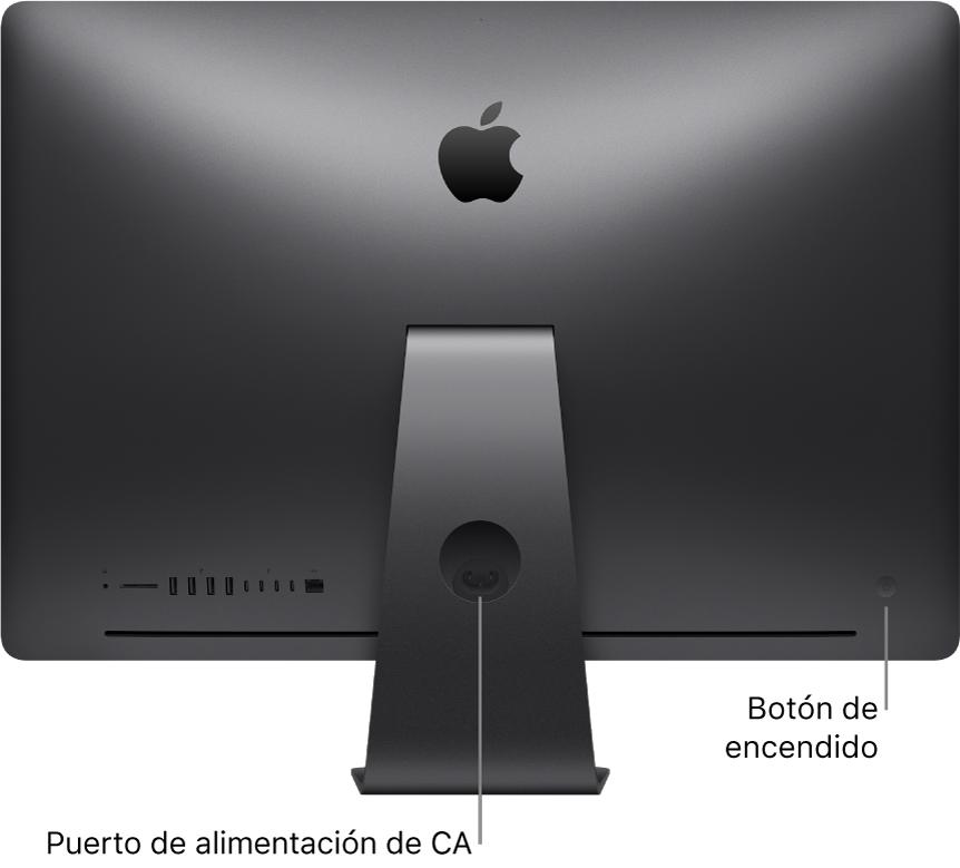 Vista trasera de un iMac Pro donde se muestra el puerto de alimentación de CA y el botón de arranque.