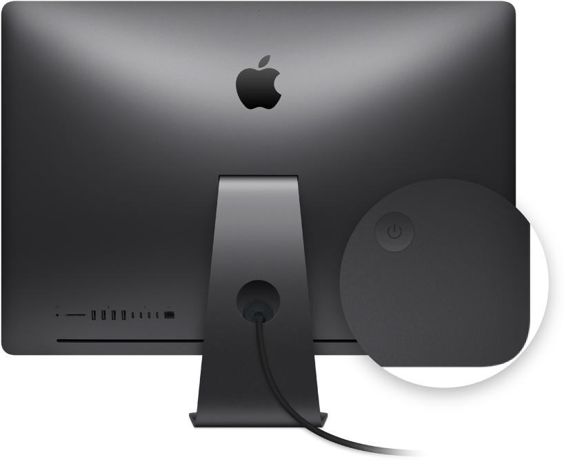 Vedere din spate a afișajului iMac Pro‑ului cu butonul de alimentare evidențiat.