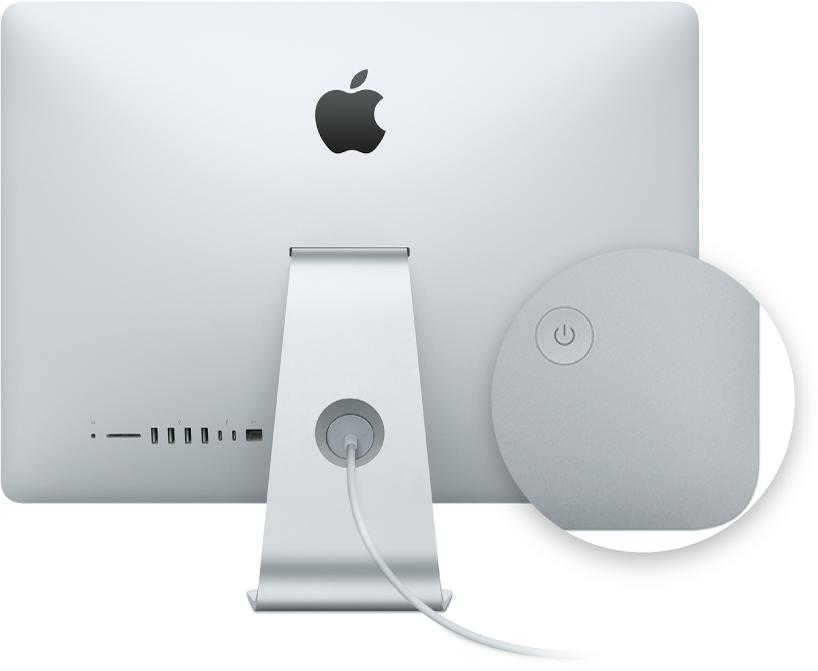 Vista trasera de una pantalla de iMac donde se señala el botón de encendido.
