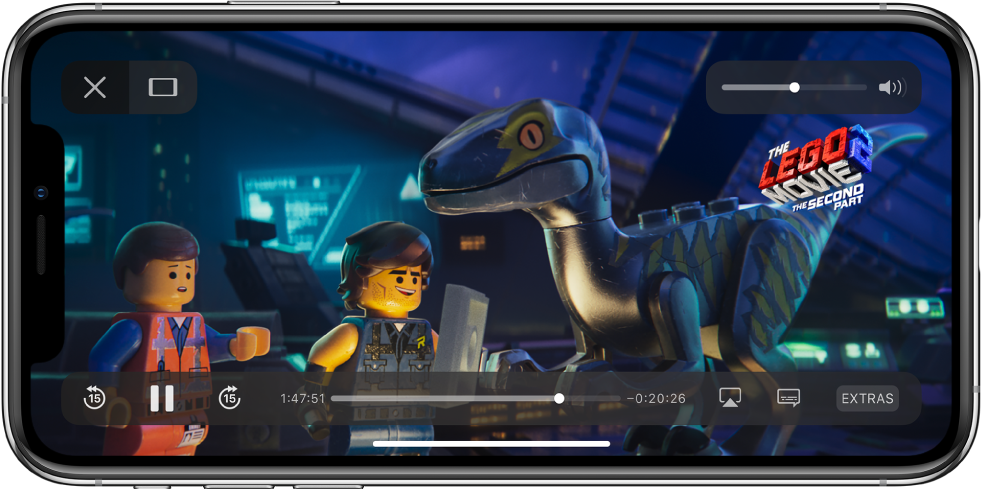 """Rodomas filmas su matomais atkūrimo valdikliais. Mygtukai """"Done"""" ir """"Scale to Fill"""" yra viršuje kairėje. Garso slankiklis yra viršuje dešinėje. Apačioje kairėje yra peršokimo atgal per 15sekundžių, pauzės ir peršokimo pirmyn per 15sekundžių mygtukai. Apačioje viduryje rodomas slankiklis, kuriuo galima keisti vaizdo padėtį; abipus slankiklio rodomas praėjęs laikas ir likęs laikas. Apačioje dešinėje yra vaizdo paskirties vietos keitimo, subtitrų rodymo ir papildomo turinio atkūrimo mygtukai."""