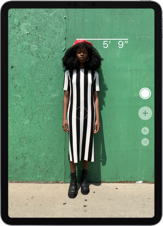 A person's height is measured, with the height measurement showing at the top of the person's head. The Take Picture button is active on the right edge for taking a picture of the measurement.