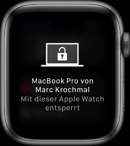 """Display der AppleWatch mit der Nachricht """"MacBook Pro von Mark von dieser AppleWatch entsperrt""""."""