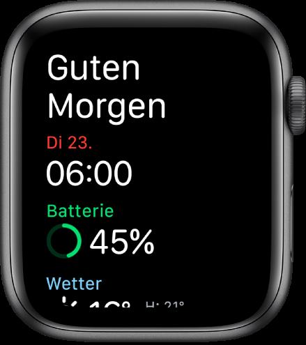 """Apple Watch mit der Begrüßung beim Aufwachen. Oben wird """"Guten Morgen"""" angezeigt. Darunter befinden sich das Datum, die Uhrzeit, die Restladung und das Wetter."""