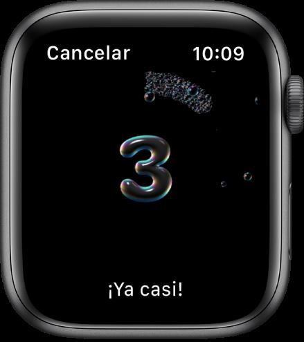 """La pantalla Lavado de Manos con una cuenta regresiva desde 3. Las palabras """"'Ya casi!"""" se muestran en la parte inferior."""