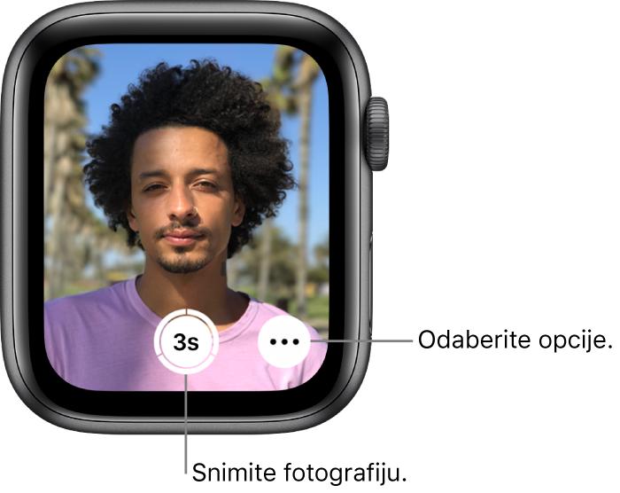 Dok se koristi kao upravljač kamere, zaslon AppleWatcha prikazuje ono što je u kadru iPhone kamere. Tipka za snimanje fotografije nalazi se u donjem središnjem dijelu, a tipka Više opcija nalazi se s desne strane. Ako ste snimili fotografiju, tipka za prikaz fotografije nalazi se u donjem lijevom kutu.