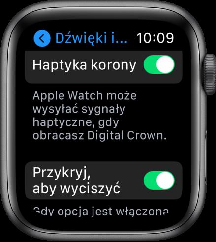 Ekran Haptyka korony, na którym widoczny jest włączony przełącznik Haptyka korony. Poniżej znajduje się przycisk Przykryj, aby wyciszyć.